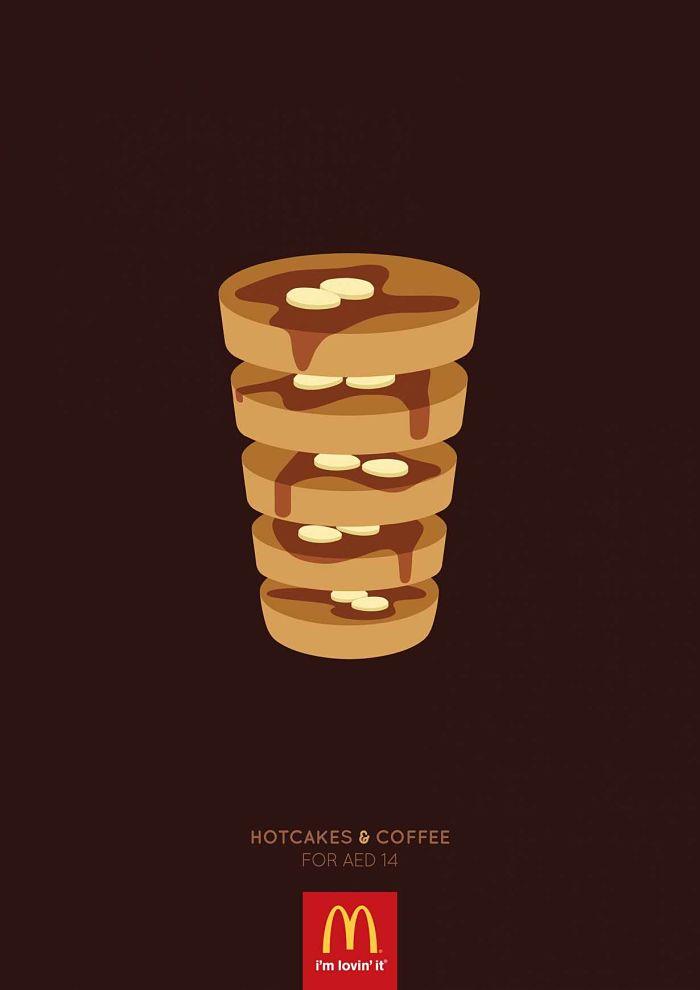 Anuncio de McDonald's. 6 tortitas con sirope y mantequilla una encima de la otra en forma de torres como si fuera un vaso de café.